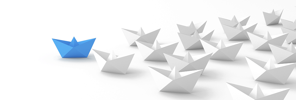 fleet of paper boats with blue boat leading
